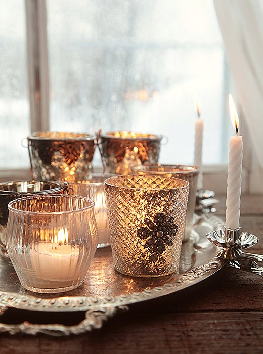Glamour and sparkle with an eclectic mix of crystal and silver votives for a traditional vibe