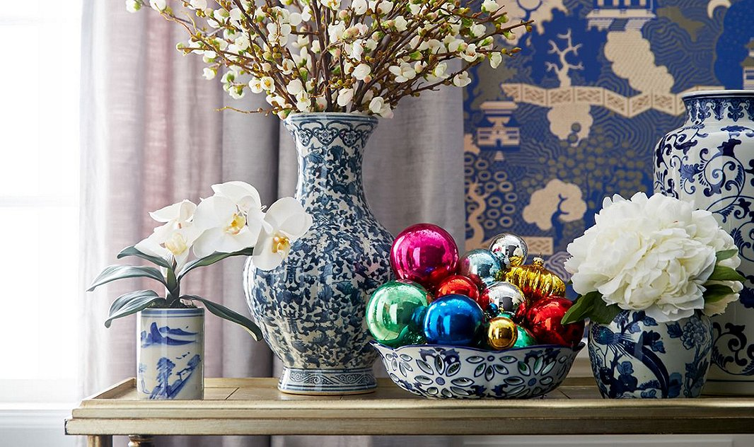 Loving this mix of chinoiserie, delicate white florals cut low and shiny orbs in a bowl for the perfect vignette - One Kings Lane