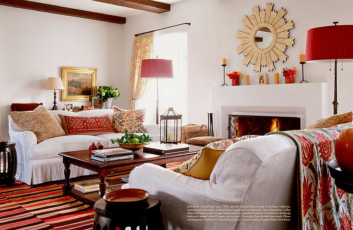 To bring instant individuality and style to your living room seek out unusual and/or vintage fabrics that can be made into cushions and throws. Using one dominant color throughout will pull the whole look together -as you can see here complementary shades of red do the trick!