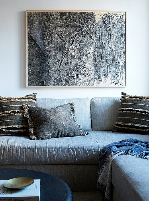 Natural textured fabrics and unfinished edges speak to the Danish Hygge aesthetic.  Photo by Manuel Rodriguez - One Kings Lane