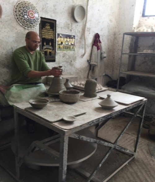 A potter in the process of make a tagine, a staple of every Moroccan kitchen