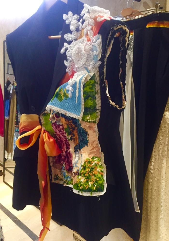 Beautiful embroidery, handwoven tapestry and ribbon - all couture details