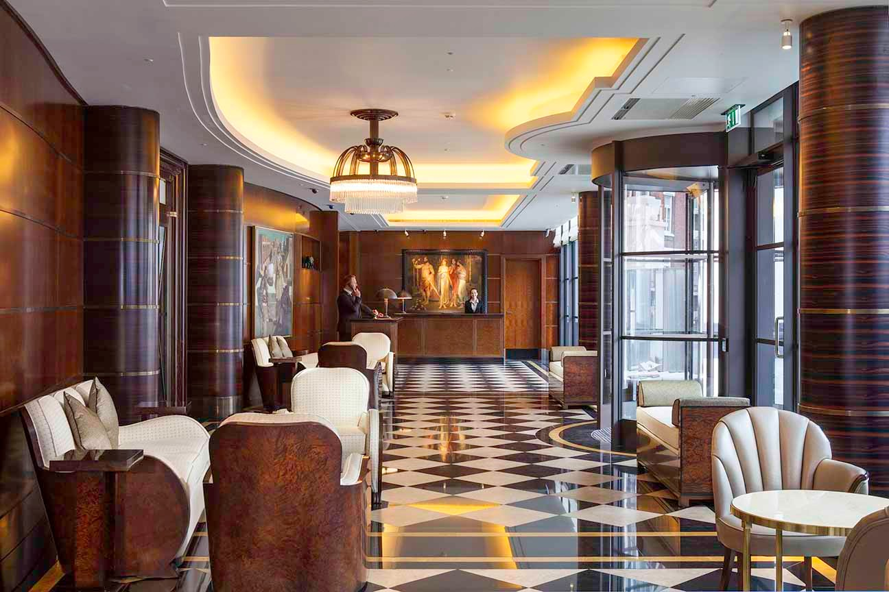 Beautiful Art-Deco details includes an interior decor of highly polished walnut finishes on furniture and wall panels -black &white marble floors add a sharp geometric contrast