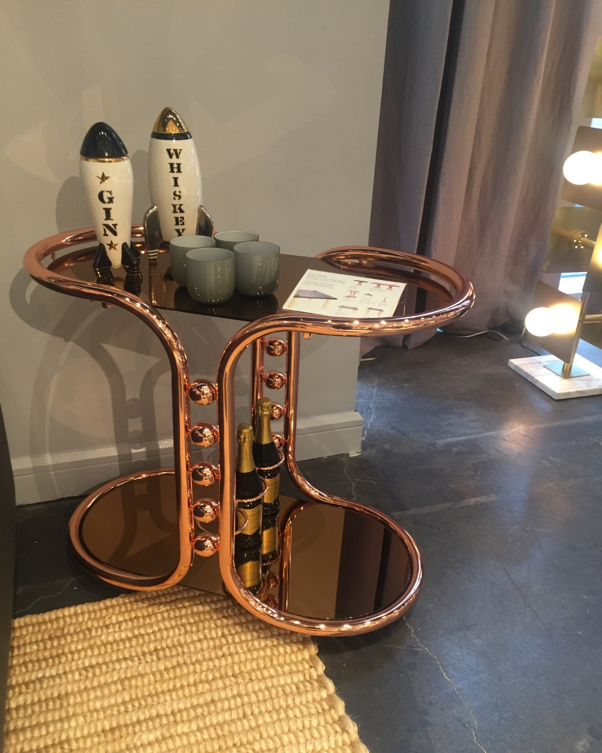 The ultra bar cart   is the most interesting cart I've seen in awhile and I'm loving the retro-vibe bronze finish