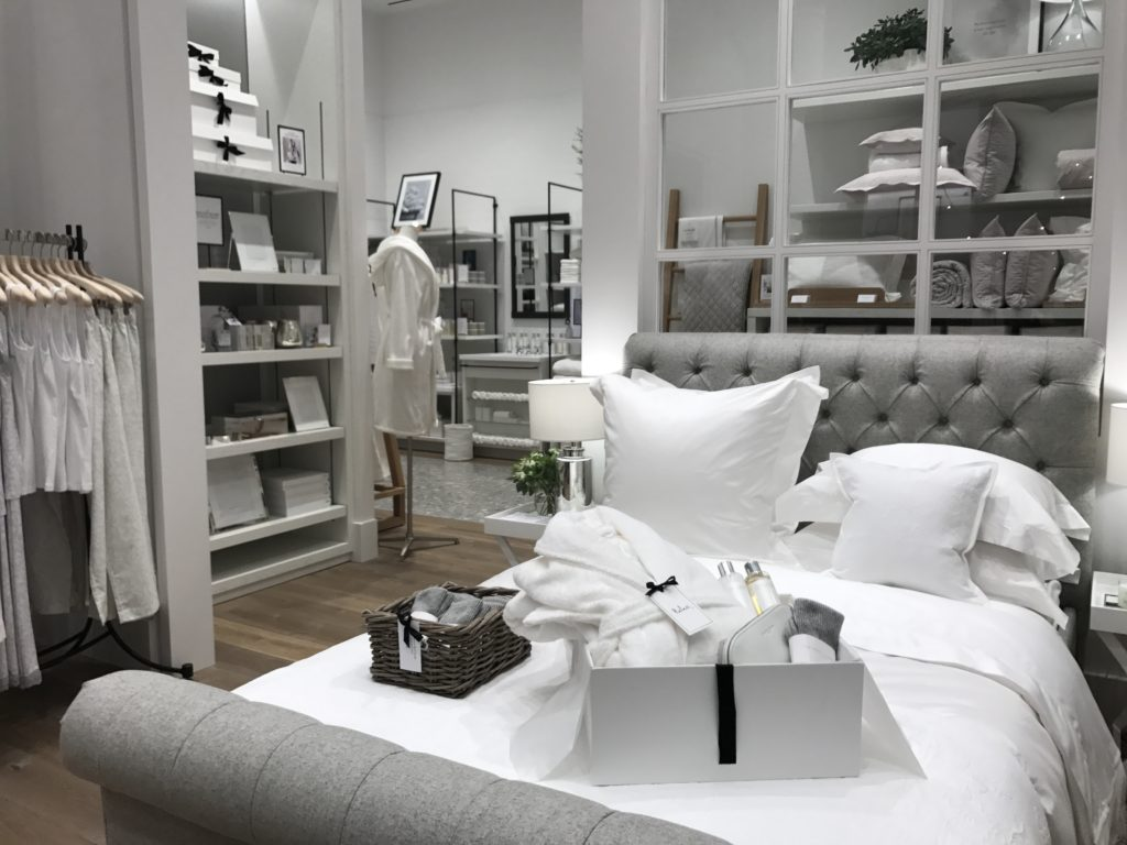 Subtle silver gray details add a little unexpected tension amongst the sea of white