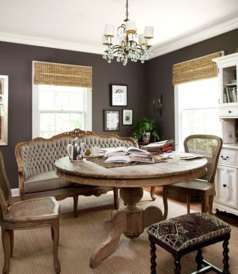 Roger Davies -Countryliving.com... the distressed wood finishes, sisal rug, woven shades and white cabinetry and a subtle pop of pattern on the bench creates a rustic-chic vibe
