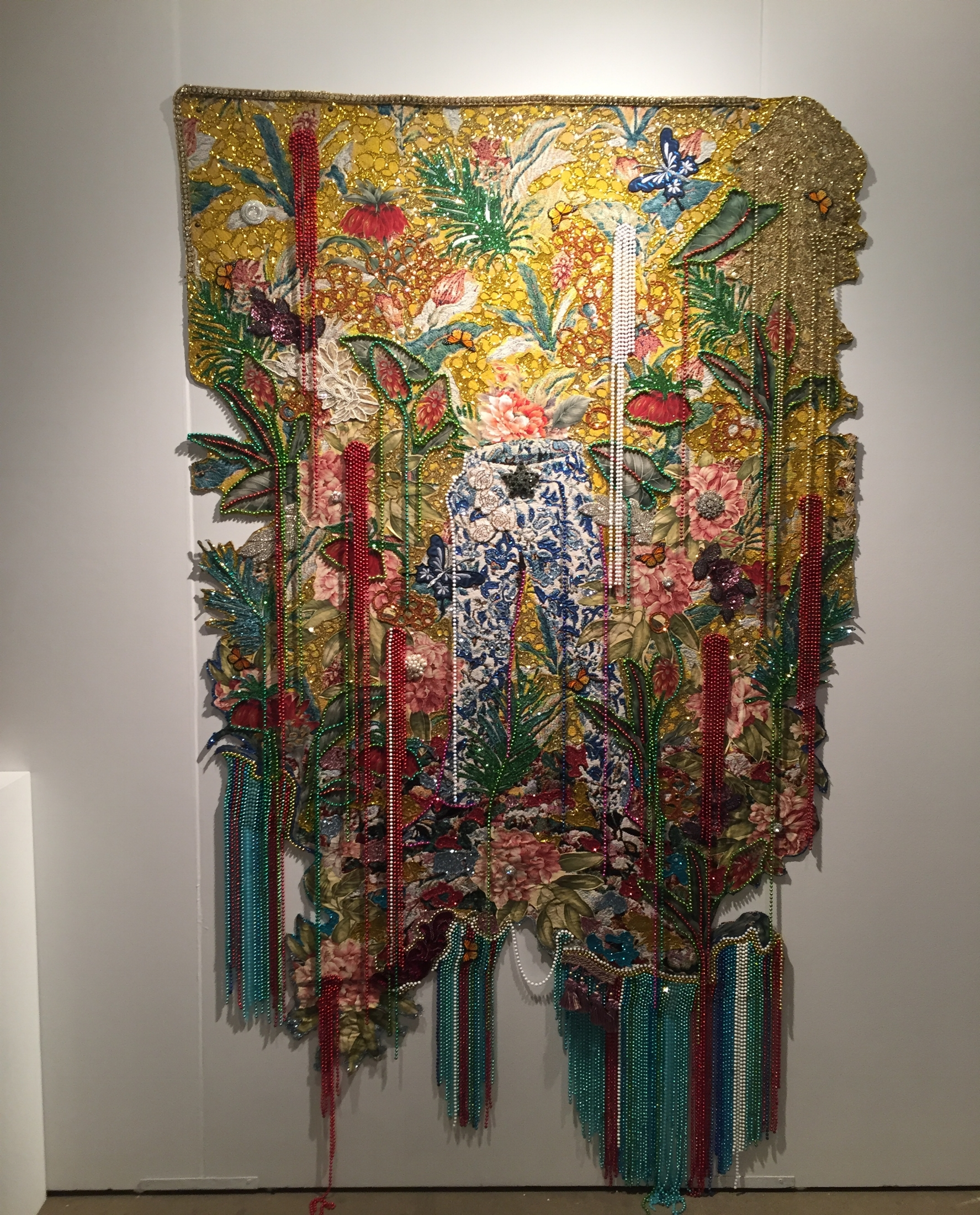 A significant wall tapestry from Ebony G Patterson at the Monique Meloche booth