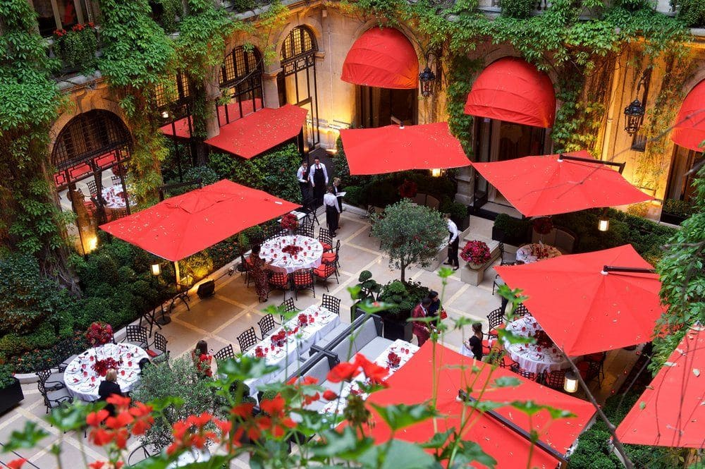 Plaza Athenée courtyard and signature red canopies
