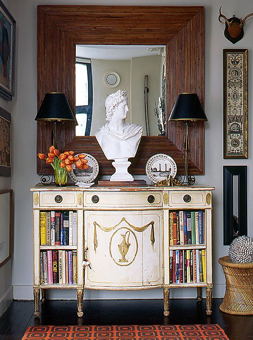 Photo by Patrick Cline /Lonny - If space is limited a cabinet can do double duty as a bookcase and there's still room for a piece of sculpture, a pair of lamps and a vase of tulips that pull in the graphic area rug -.scale and balance are key