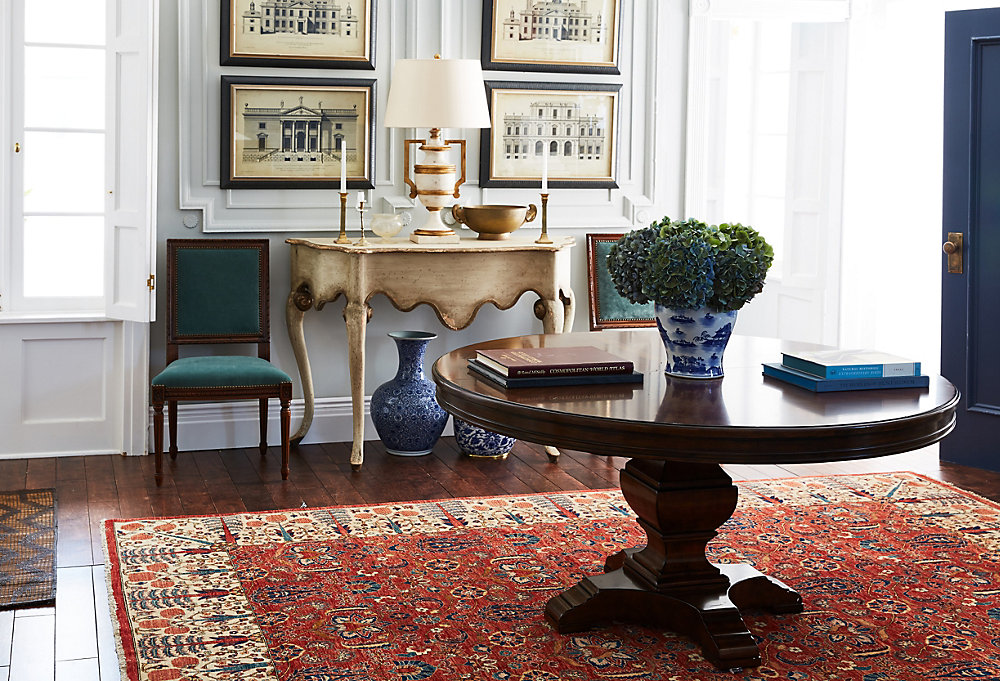 English Traditional - One Kings Lane  -  nothing says gracious living quite like an entry with a circular table sitting atop a densely patterned antique area rug