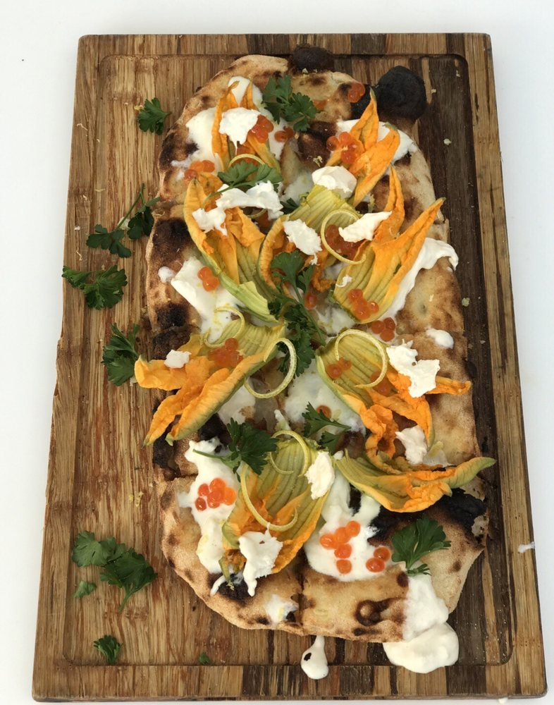 """The daily special was a mozzarella """"fior di lotte"""" pizza topped with zucchini flowers,caviar and basil leaves"""