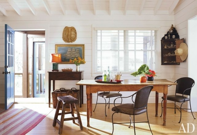 Mix your periods - here's an eclectic mix of Vintage iron chairs and bench, Swedish farmhouse table and an English corner cabinet... Photography Pieter Estersohn