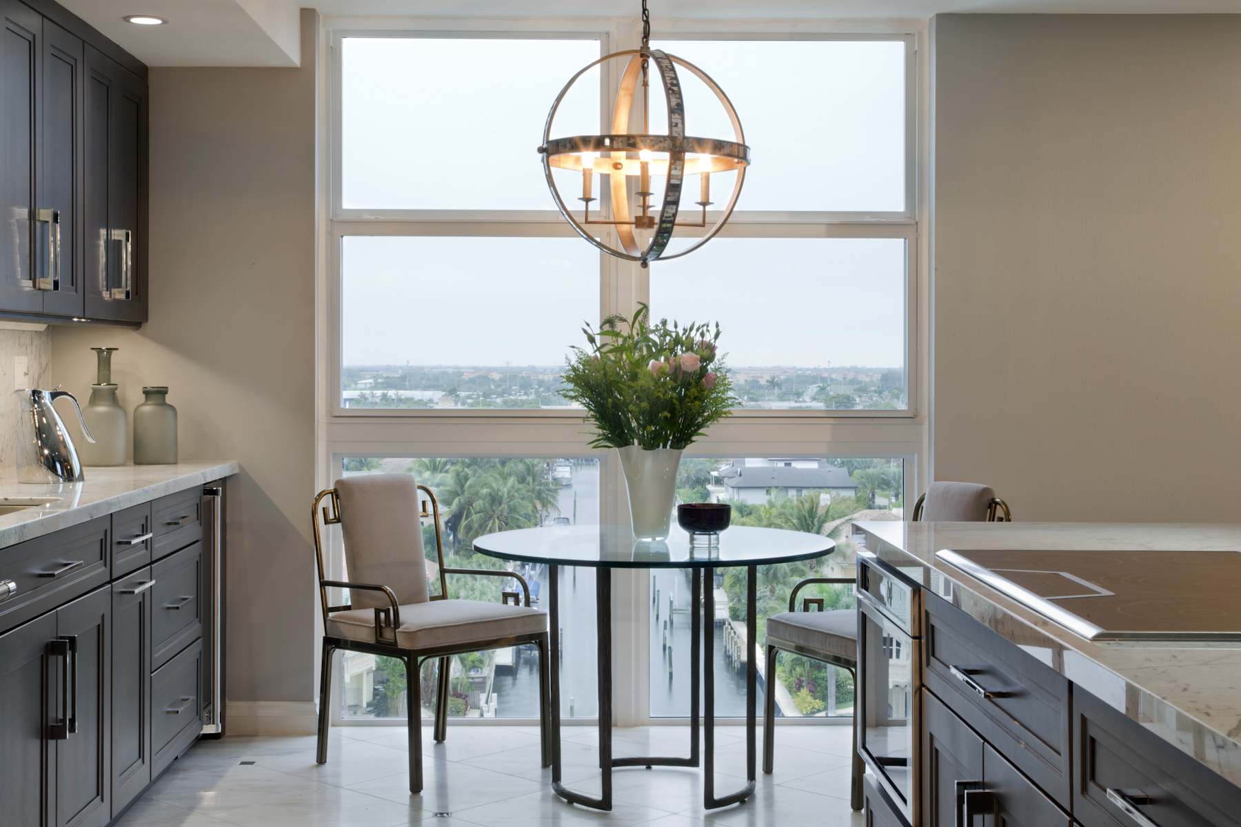 An eyecatching chandelier or pendant fixture is the statement piece to bring drama and glamour to your dining experience... Design Doreen Chambers Interiors