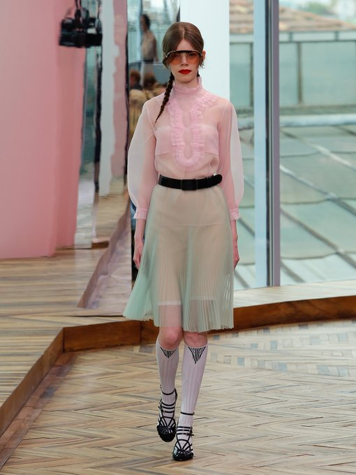 Pretty pastels with delicate ruffle pleated details of  Prada ruffle trimmed organza top and  high-rise pleated skirt