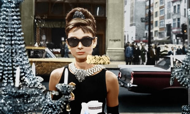 """This little black dress that launched millions of LBD's - so iconic it sold at Christie's auction December 5 2006 to an anonymous buyer for $923,187...""""The little black dress is the hardest thing to realize,"""" Givenchy said, """"because you must keep it simple."""" Audrey Hepburn in Breakfast at Tiffany's. Photograph: Paramount/Kobal/Rex/Shutterstock"""