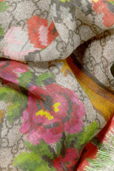 A well chosen throw that goes with everything for the occasions where nothing less than a full head coverup is required -  Gucci silk blend scarf