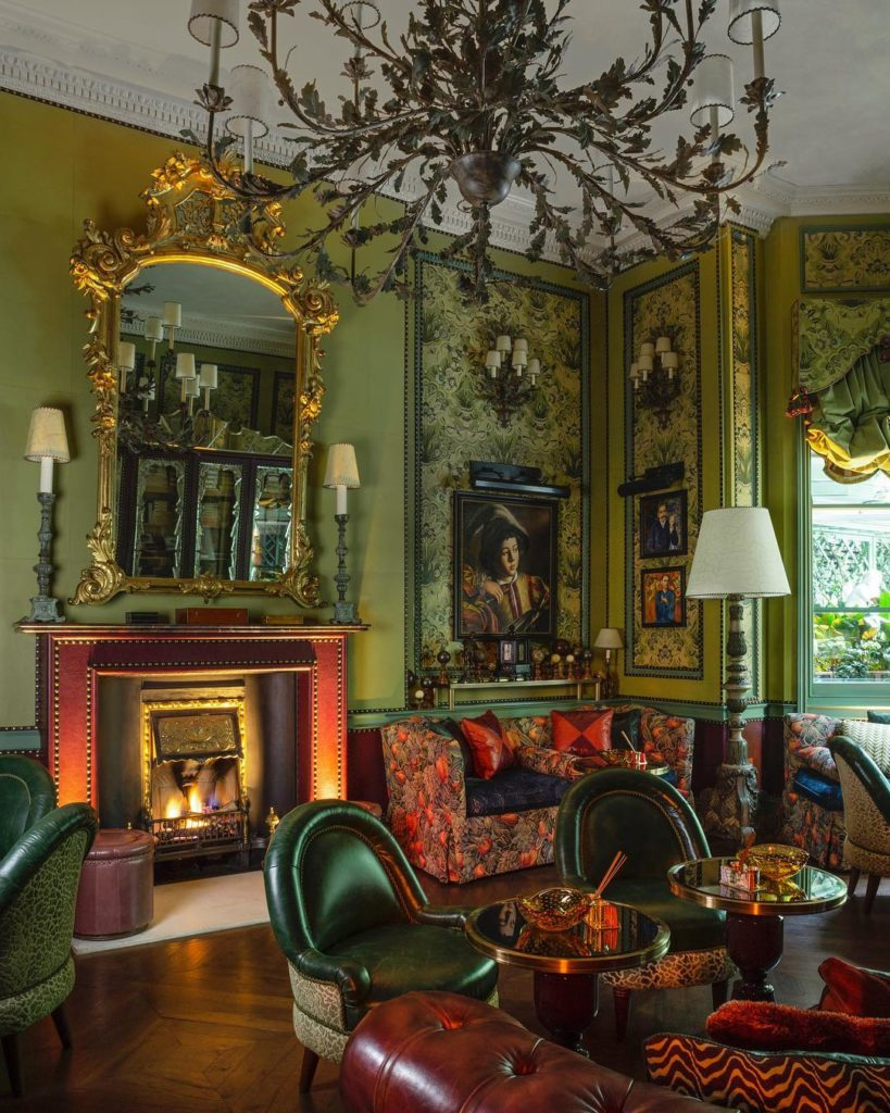 For this me this room has a definite victorian vibe - perhaps it's the red &green color palette and leather chesterfield