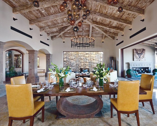 What a beautiful room and loving the generous open plan layout - the chandelier and crystal globes from John Pomp Studios refine the rustic reclaimed wood vaulted ceiling