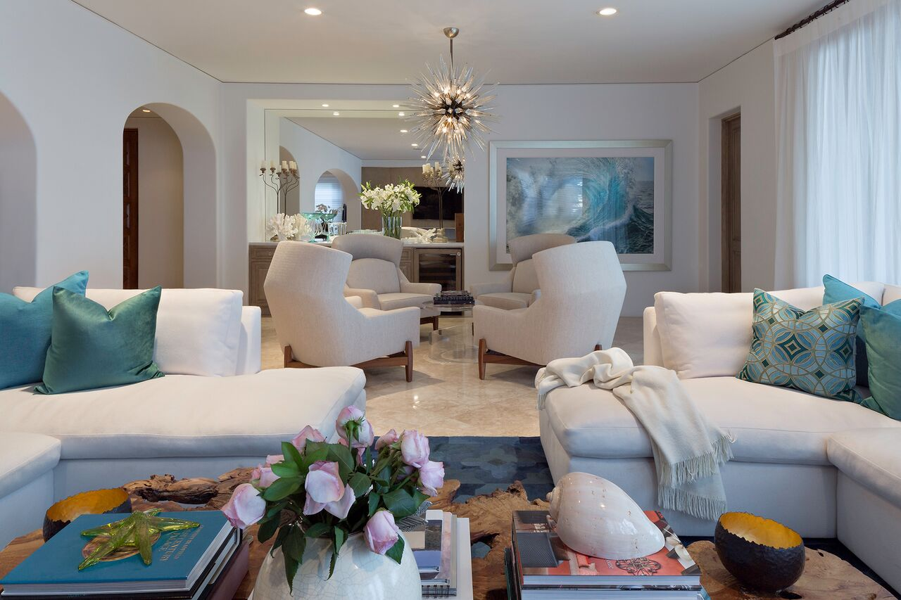 A sumptuous bar area highlights classic Ralph Pucci club chairs and an extraordinary vintage Venetian cloudburst chandelier
