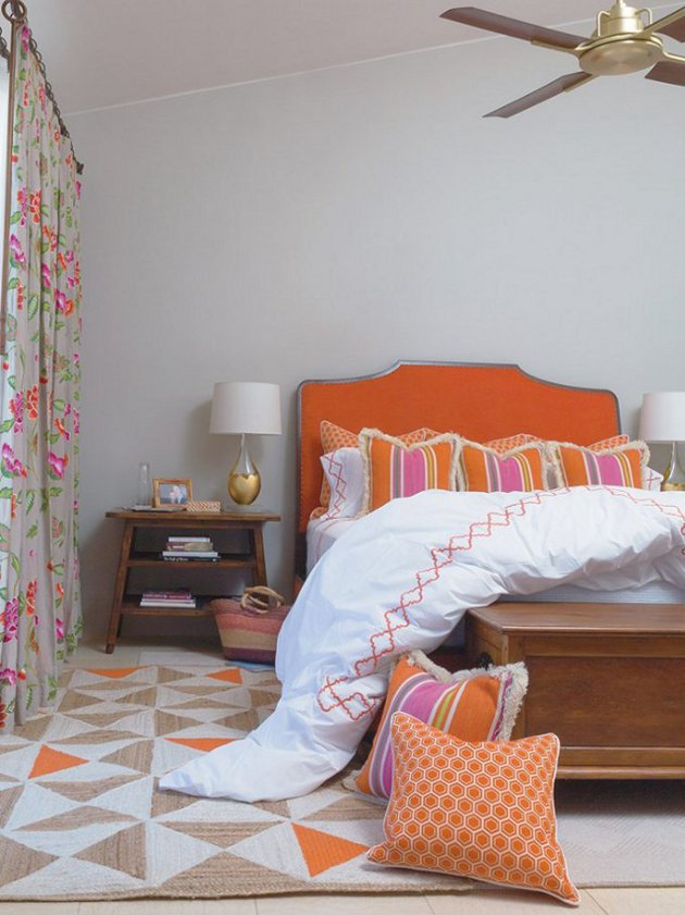 Loving the mix &match patterns combined with a vivid color palette of fuchsia, pink and orange grounded by the soothing grey walls