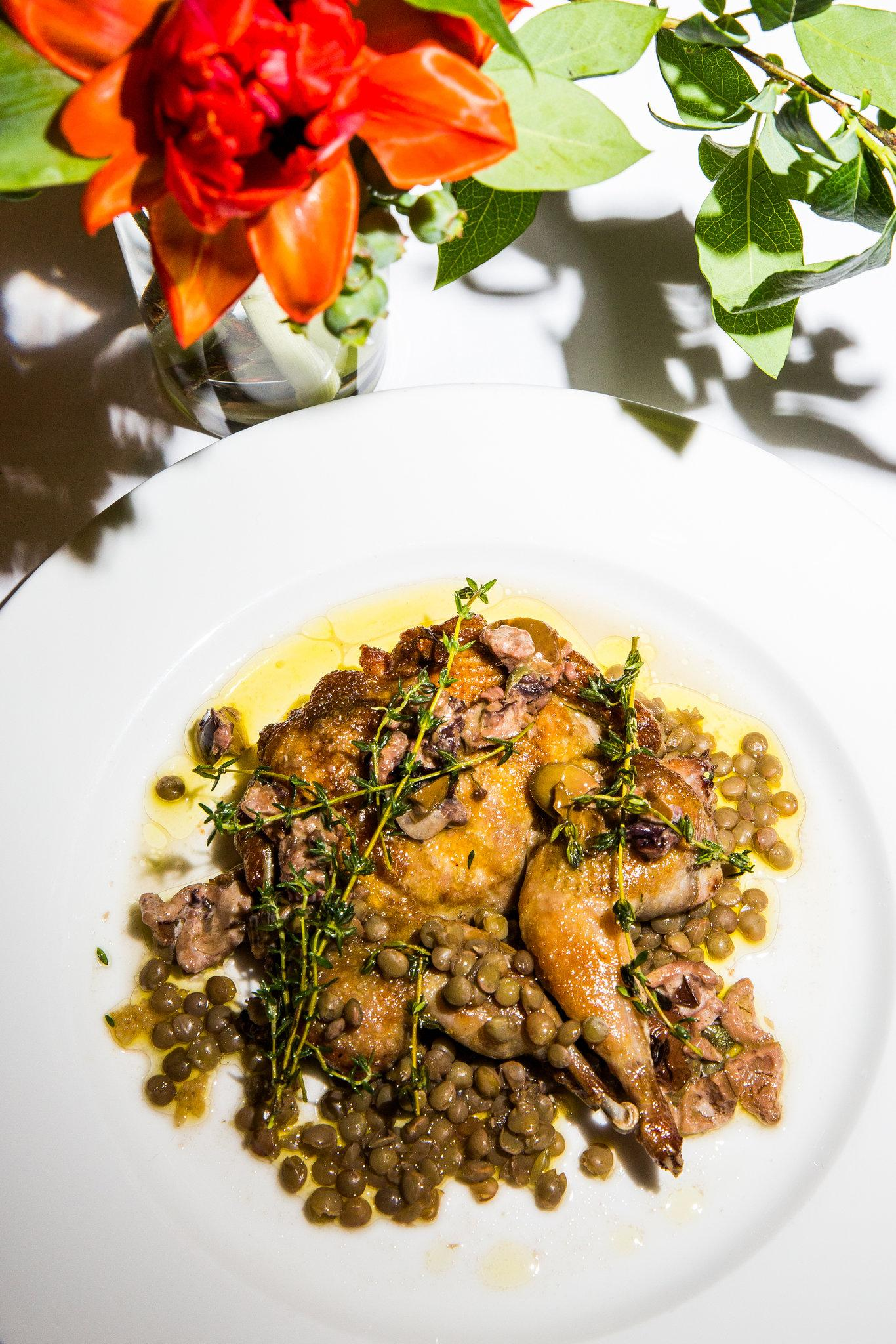 Roasted quail with flowering thyme, lentils and tapenade