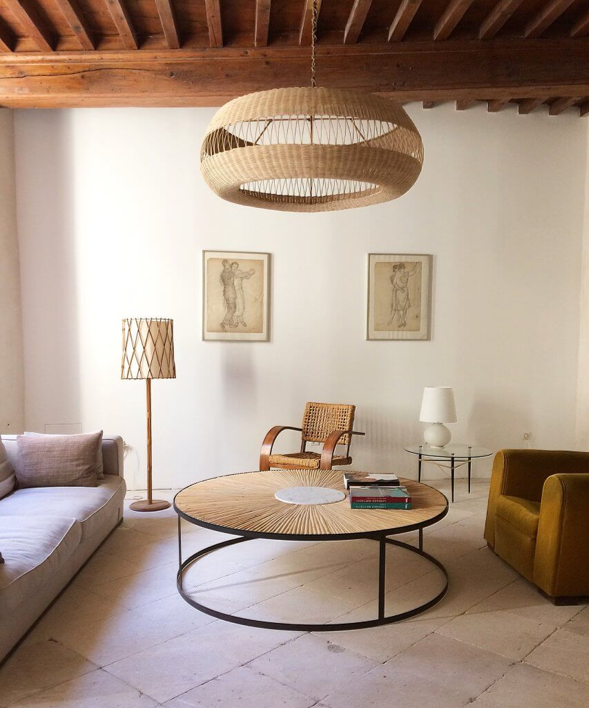 XXL rattan marquetry table fits seamlessly with the Adrien Audoux & Frida Minet 1940s armchair and leather club chair