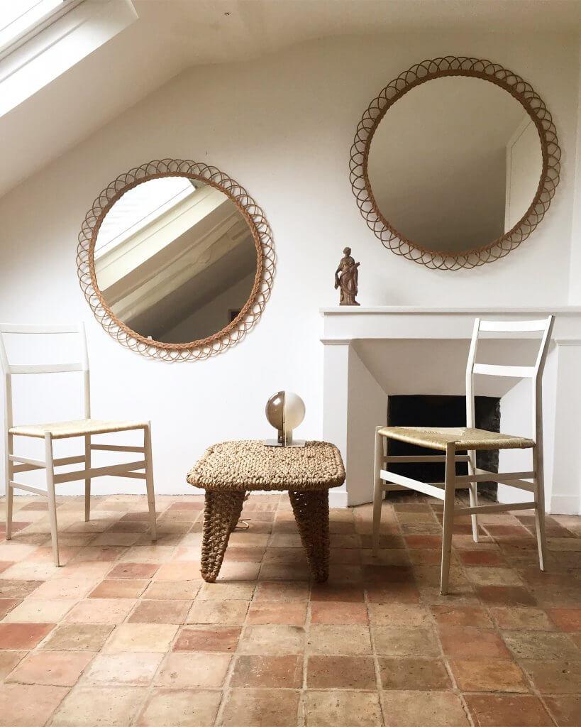 atelier-vime-round-woven-rattan-wall-mirrors-wicker-tile-floors-france-white-walls.jpg