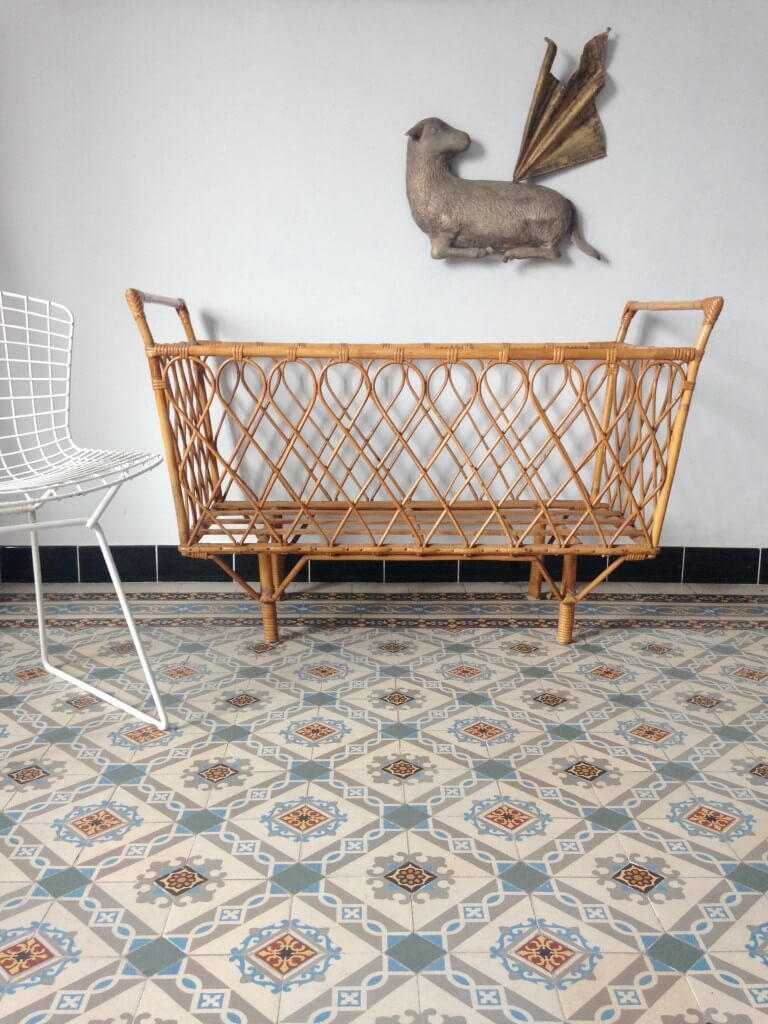 It's as much about the beautifully tiled floor as it is about the custom crib that looks like an art installation in this setting