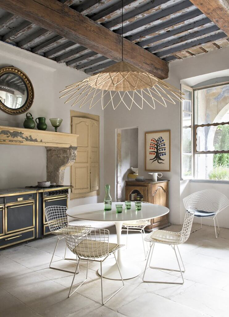 """""""Gabriel"""" suspension light fixture complements the polished surfaces of the Saarinen table and Betoia dining chairs"""