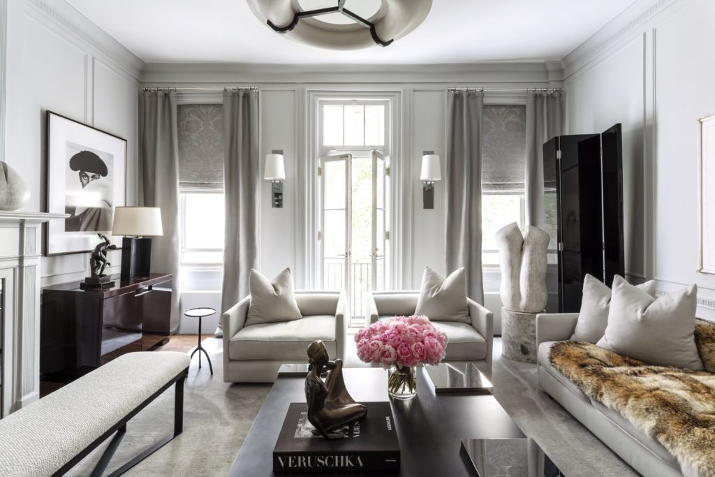 To add dimension to a room's otherwise neutral palette pop it with a lush bouquet of vibrant pink peonies