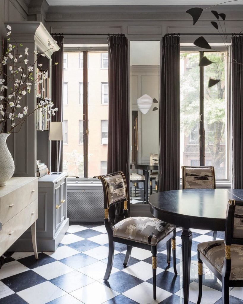 The Maison Jansen dining table and custom regency-style dining chairs caught my attention...checkerboard patterned floor tiles make the room a little less formal but maintains the glam!
