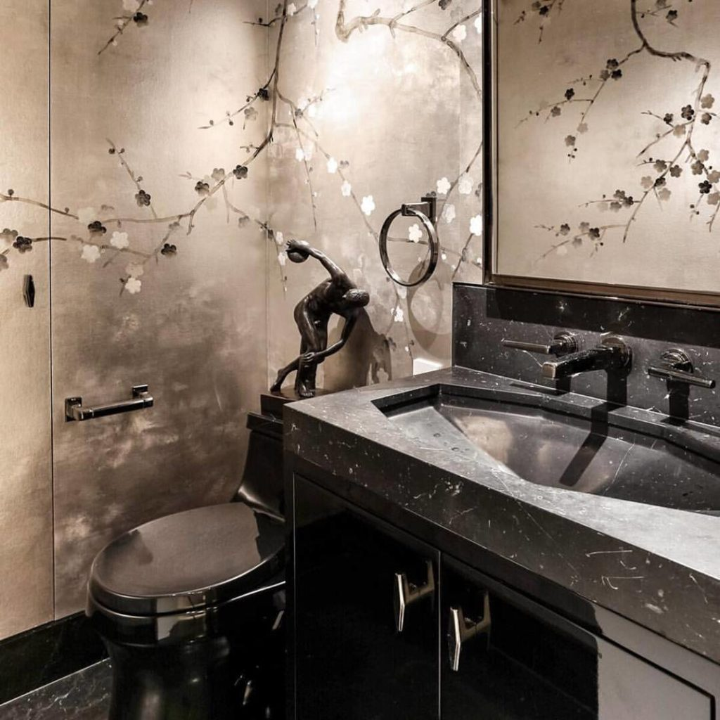 A delicate floral Japanese-inspired wall treatment sets the tone for the jewel box powder room