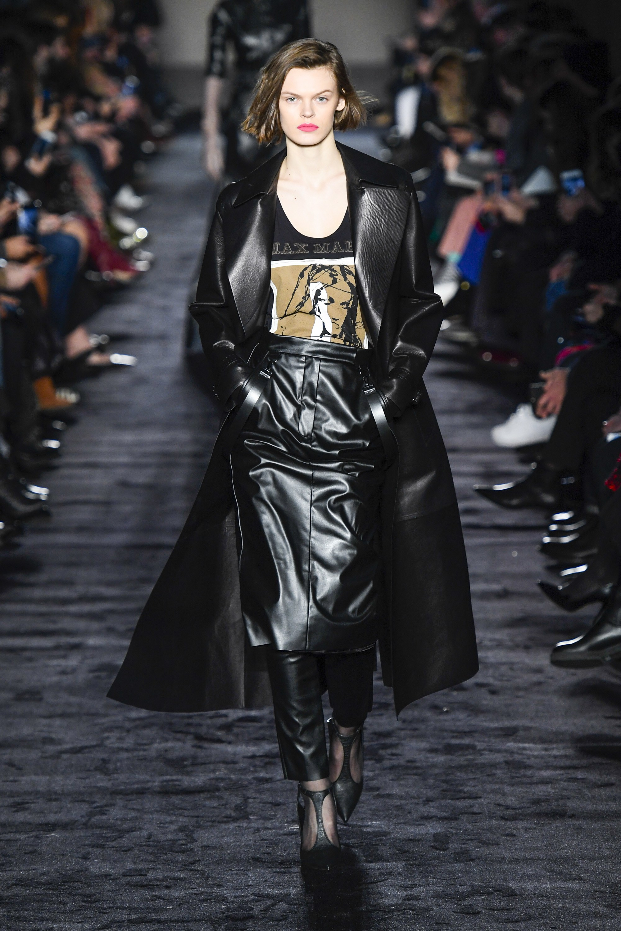 Max Mara Ready-to-Wear Fall 2018  moves onto leather again with pants layered under the skirt