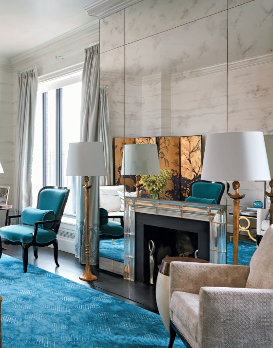 Love the layering of drapes, rug, luxe fabrics, Asian screen, mirrored wall & fireplace - relying on texture rather than pattern so the room doesn't look overdone