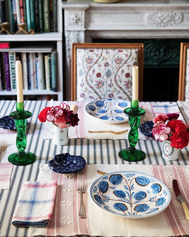 caroline-irving-and-daughters-home-place-setting-table-plates-blue-and-white-green-glass-candlesticks-seashell-striped-tablecloth.jpg