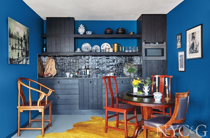 Hague Blue by Farrow & Ball covers the walls making a vivid backdrop for this compact 860 sq ft 2-bedroom apartment