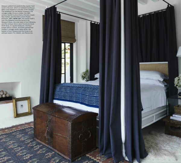So many of us own antique mahogany blanket chests and it looks great in this tailored navy and white bedroom.  Design by Rela Gleason