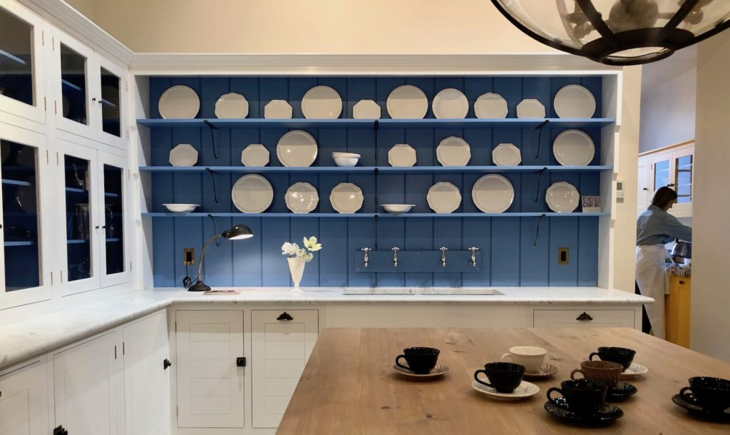 Open shelving showcases white creamware ceramics from the   Frances Palmer Pottery Cirrus Collection - manufactured by 1882 Ltd