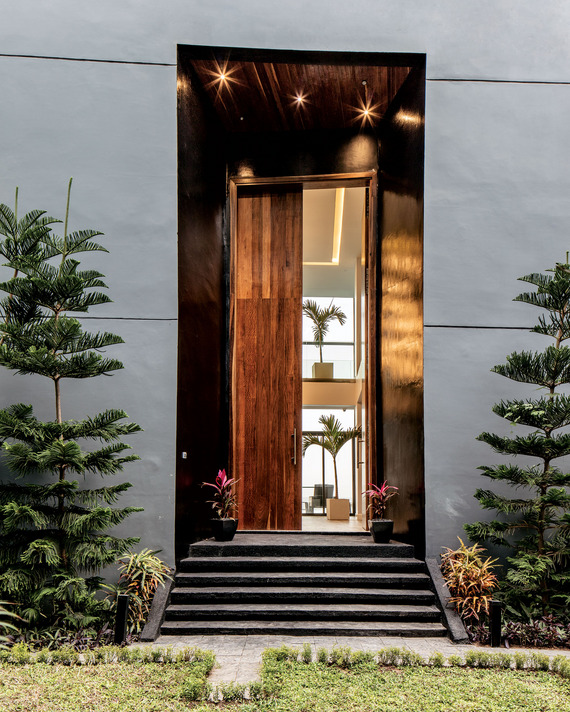 Entry through the dramatic double doors lead to the grand foyer within