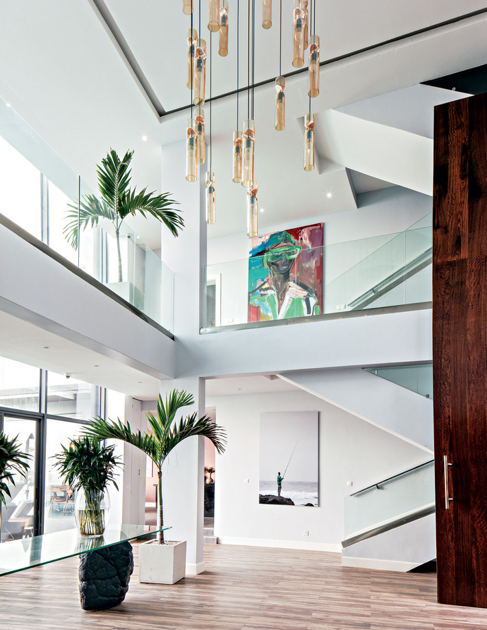Artworks by Dwayne Rogers (ground floor), Ngimbi Luve (second floor), lush palms and clean architectural details are the main event of the grand foyer