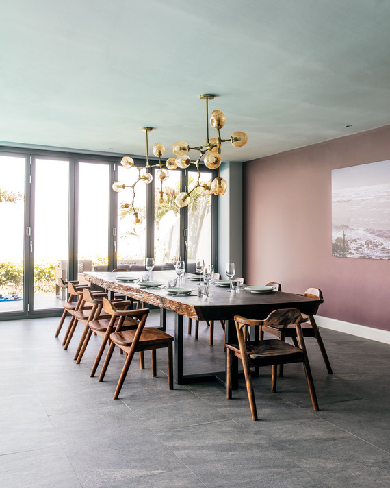 The dining room's muted palette highlights the gorgeous live edge dining table