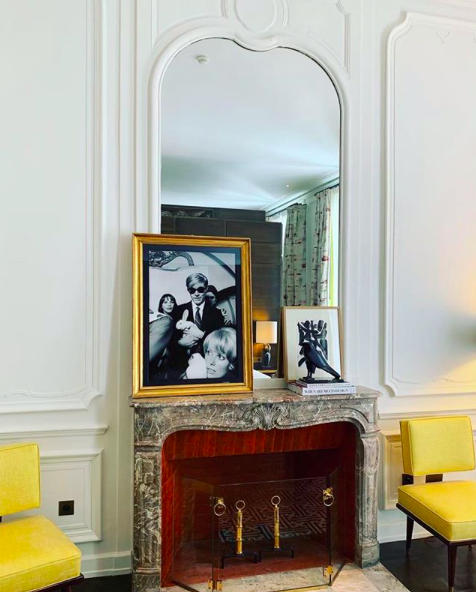 Layering artworks casually against the mirror is a very nice touch that could be applied in your own home if you happen to own a marble mantel