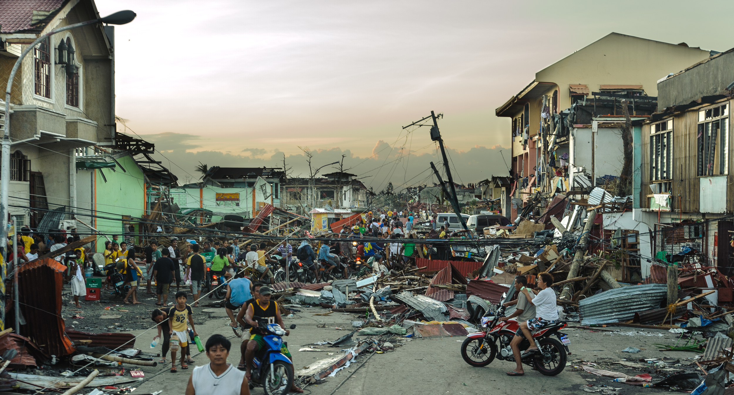 Dusk along the main road into Tanauan, 48 hours following the landfall of Typhoon Haiayan.