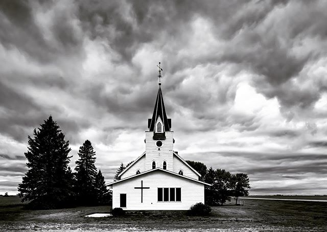 Scandia Church. Ada, MN. Minnesota never fails. With only half a day off, I found these clouds rolling across the plains at dusk. 🙏❤️🙏 #minnesota #clouds #bnw_planet_2019 #bnwlandscape #bnw_rose #moody #minimalist #blackandwhitephotography #landscapephotography #bnw_greatshots #church #bnwphotography #fineart_photobw #fineartphotography #monochrome #nikond850 #sigma24mmart #adaminnesota