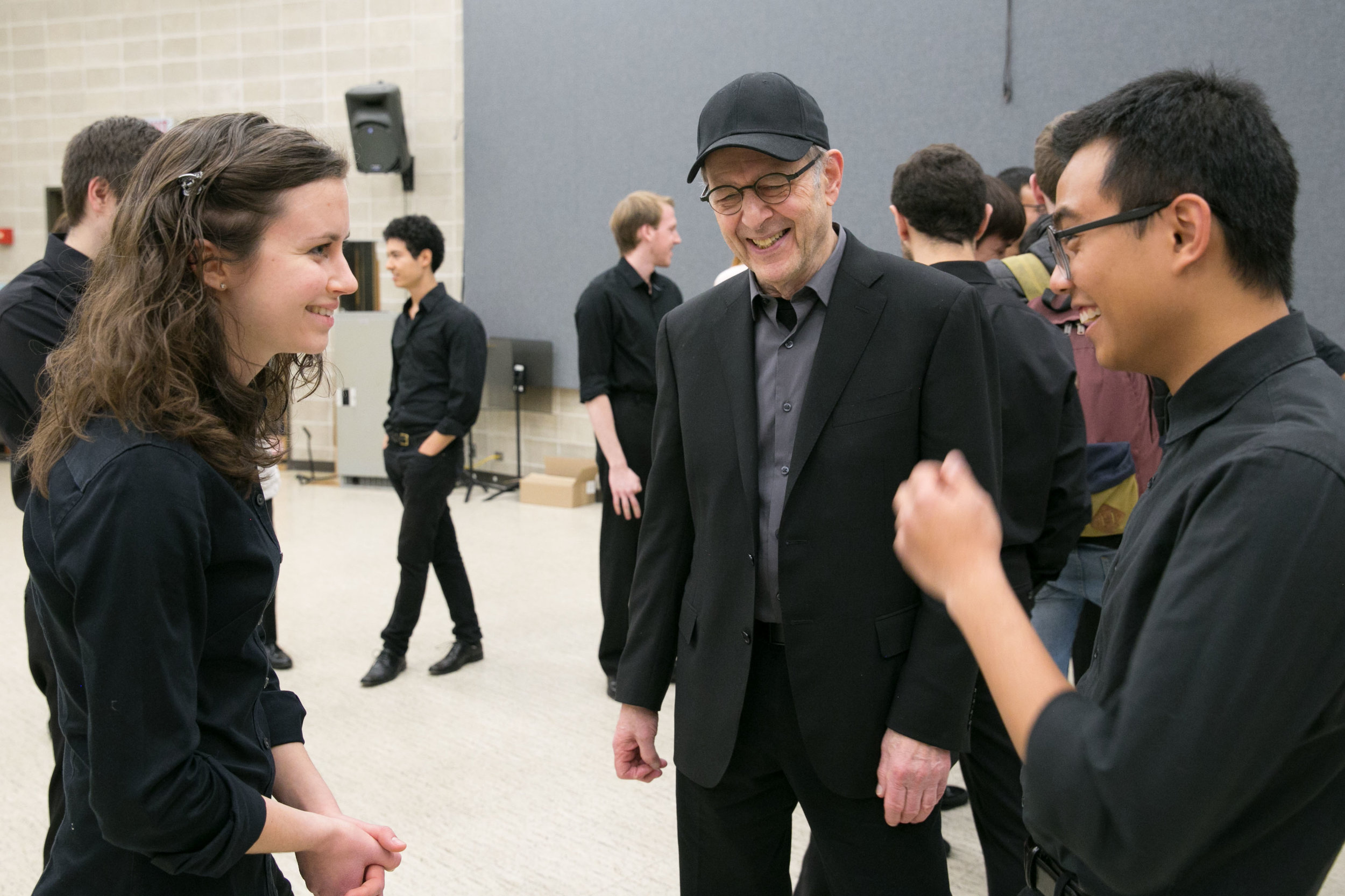 Steve Reich backstage with percussionists at Northwestern University.
