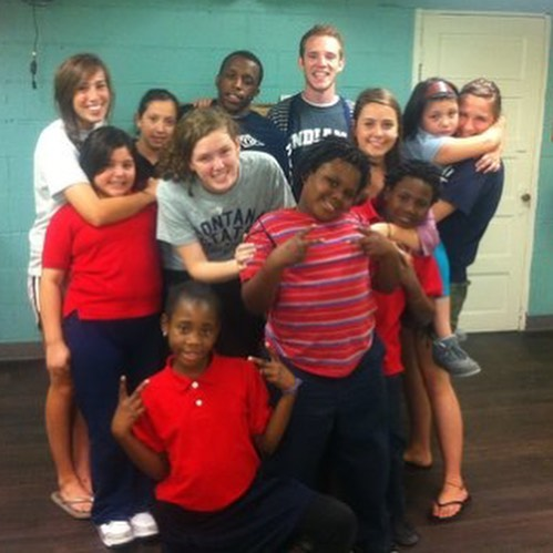 """It all began in May of 2012. 4 girls, Sara Rogers (18 years old), Rachel Milkie (21 years old), Madison Pascascio (17 years old) and Maddie Luros (16 years old) had all been regular volunteers at an after school program on the east side of Indianapolis. They received news that the branch they worked at would be closing, leaving many of the children without a program to attend. These girls had spent 2+ years falling in love with the kids and the community they served. Devastated by the news, they demanded answers. With a lot of passion and a bit of teenage angst, they met with someone from the organization's upper management. They drilled him with questions and fought for any way to keep the program going. Looking back now, they see the reasons the program had to close that branch, but at the time their minds were flooded with pain, disappointment and fear for what would happen to the kids. After the meeting ended, the 4 girls stood on the front porch on this organization, feeling defeated. In their moment of discouragement, Rachel stated, """"It's OK! We will just start our own organization!"""" With a rally cry of yeses, the girls spoke Like a Lion into being in that moment. Since that day on the front porch, they never looked back. From that moment on, they did everything in their power to make Like a Lion a reality."""