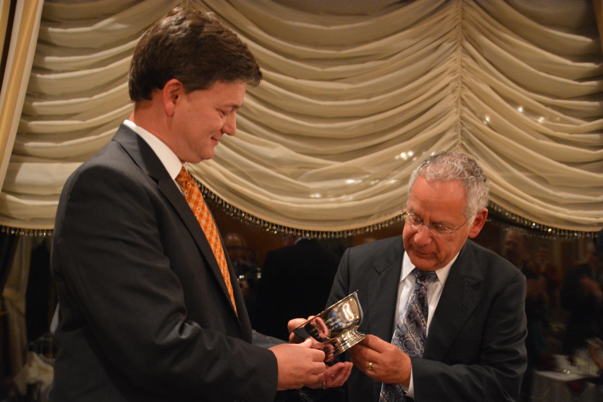 LBA President Paul Klehm presents a 50-year distinguished service award to former president, Jim Krasnoo