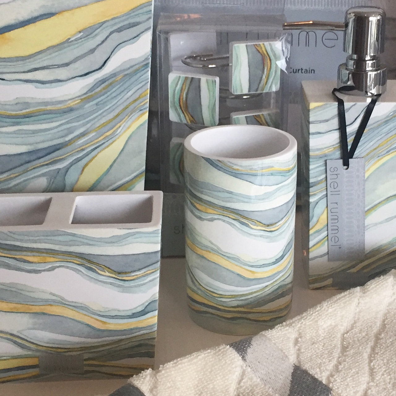 Sandstone collection offers a full range of bathroom textiles and accessories in a modern marble design.