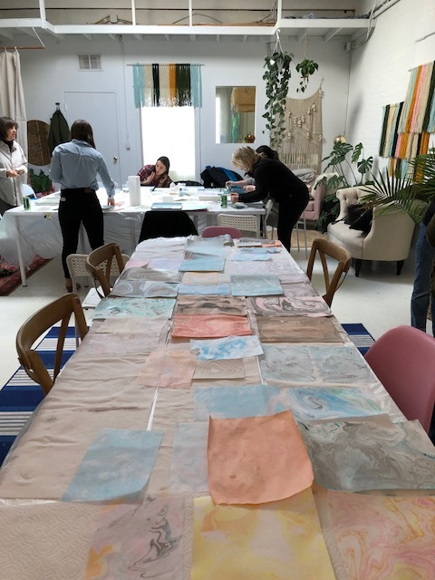 Marbled papers drying at Common Room Studio