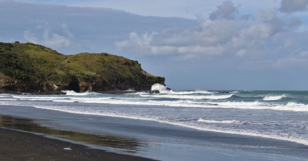 Morning surf at Muriwai Beach.